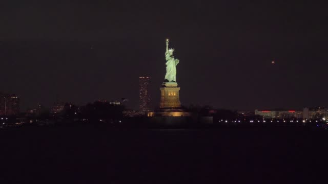 Illuminated Statue of Liberty at Night. New York City. View from the Water