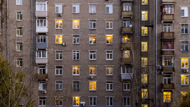 illuminated windows of dwelling house time lapse - appartamento video stock e b–roll