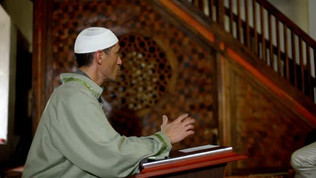 imam preaching in a mosque - moské bildbanksvideor och videomaterial från bakom kulisserna