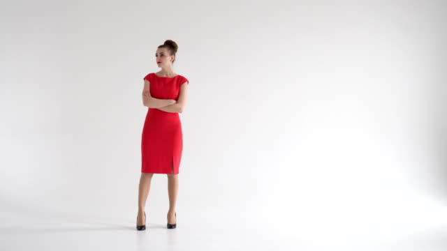 Impatient businesswoman in red dress waiting for someone Full-length of impatient businesswoman in red dress waiting for someone full length stock videos & royalty-free footage