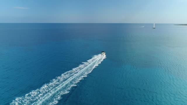 Impetuously moving launch in the Mediterranean sea, Nissi Beach, Ayia Napa, Cyprus. Aerial drone shot. video