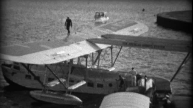 1935: Important people exiting Pan Am Sikorsky S-40 sesquiplane amphibious flying boat. video