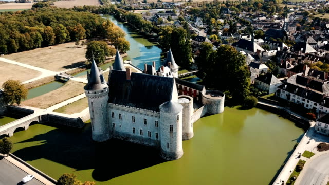 imposing medieval fortress of Chateau de Sully-sur-Loire Picturesque autumn landscape with imposing medieval fortress of Chateau de Sully-sur-Loire, France castle stock videos & royalty-free footage