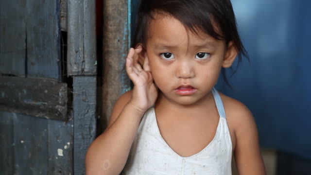 HD impoverished Asian girl Young girl living in poverty in Manila, Philippines. one girl only stock videos & royalty-free footage
