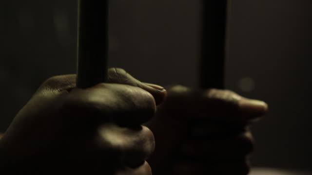 Imprisoned man.  Hombre encarcelado.
