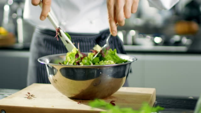 In a Famous Restaurant Cook Prepares Salad. Working in a Big Modern Kitchen. video