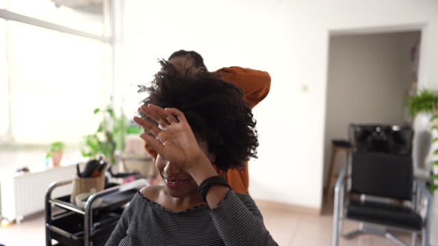 In a hair salon Video of a young female hairdresser blow-drying hair to a customer hairstyle stock videos & royalty-free footage