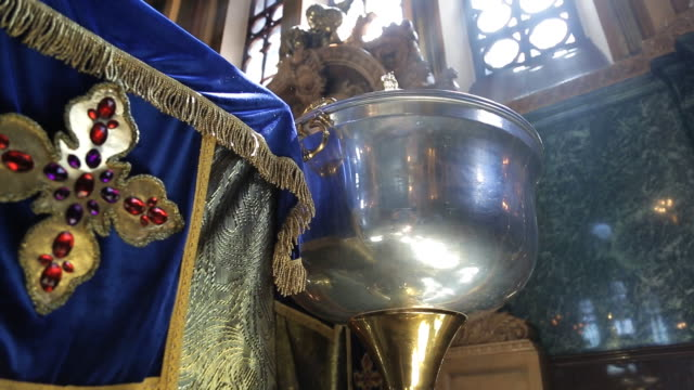In a religious temple a metal bowl is illuminated by a sunbeam video