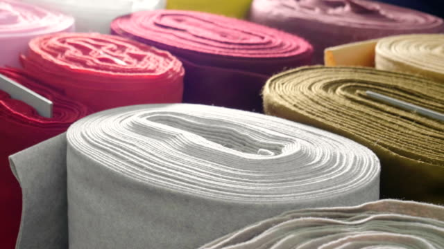 in a textile shop, there are fabrics of various colors and various materials, such as fabric, lace, satin, linen. - rotolo video stock e b–roll