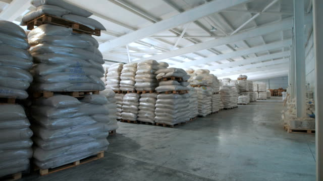 In a warehouse in bags rice, groats and a flour is prepared for sending to the consumer video