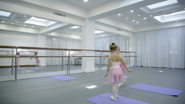 In ballet school children play and dance funny and move their hands video