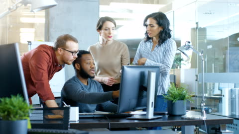 In Busy Corporate Office Team of Diverse Young Creative People Work on a Problem Solution. Collectively They Try to Help Coworker to Solve Problem. In Busy Corporate Office Team of Diverse Young Creative People Work on a Problem Solution. Collectively They Try to Help Coworker to Solve Problem. Shot on RED EPIC-W 8K Helium Cinema Camera. creative occupation stock videos & royalty-free footage