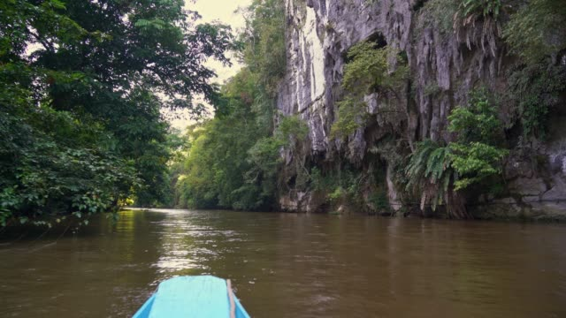 In front of Clear water cave by boat close to Deer cave, Borneo islands