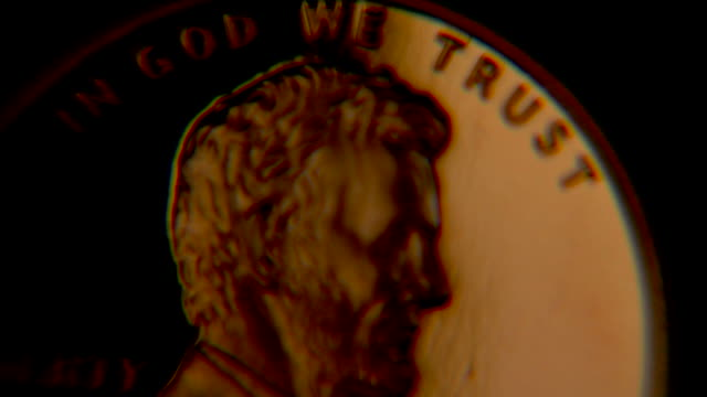 In God We Trust - Abe Lincoln, penny close up video