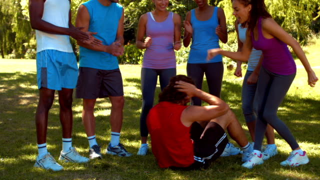 In high quality format fitness group encouraging man video
