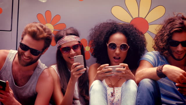 In high quality format hipster friends using their phones video