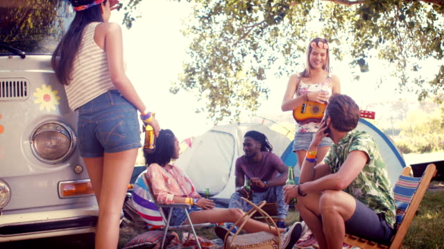 In high quality format hipsters having fun in their campsite video