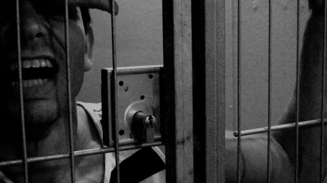 In jail Furious prisoner in jail. sentencing stock videos & royalty-free footage