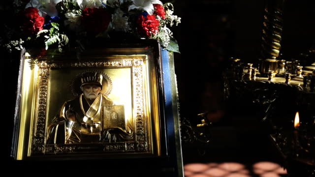 In light beam there is an icon with image of holy man with flowers. St. Nicholas video