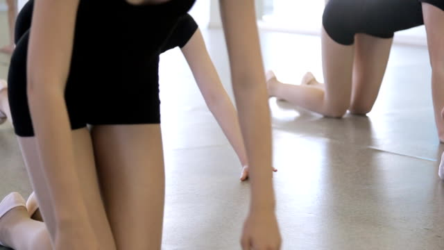 In model school young and beautiful women are lifting from the floor video