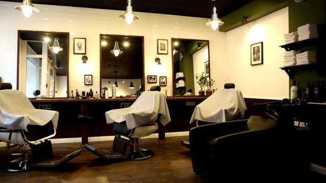 In salon hairdressing salon there are three workplaces and dryer for hair which stand opposite to mirror video