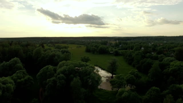 In the countryside at sunset, aerial view video