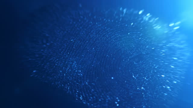 In the dark with blue illumination on a smooth surface, a distinct fingerprint