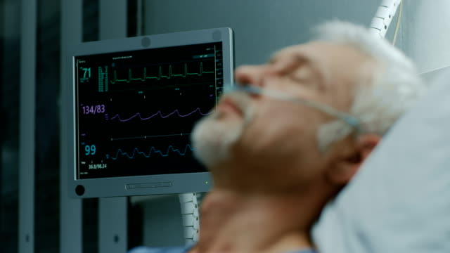 In the Hospital, Close-up Footage of Senior Patient Lying in Bed, Sleeping. Modern Hospital Geriatrics Ward.