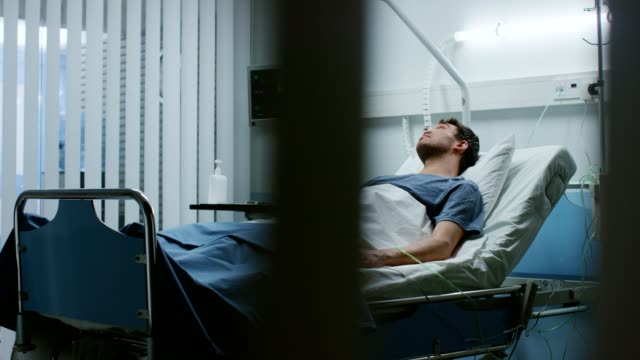 In the Hospital, Sick Male Patient Lies on a Bed, Fighting the Disease. Clean and Comfortable Medical Ward. In the Hospital, Sick Male Patient Lies on a Bed, Fighting the Disease. Clean and Comfortable Medical Ward. Shot on RED EPIC-W 8K Helium Cinema Camera. cancer patient stock videos & royalty-free footage