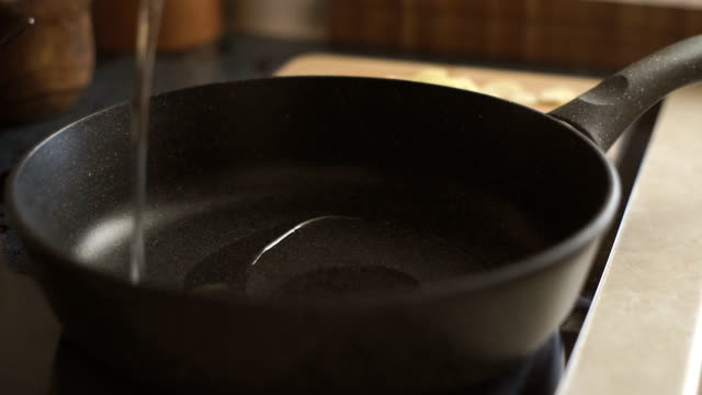 In the saucepan pour vegetable oil video video