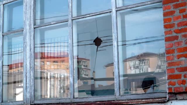 In the window of the kindergarten, hooligans broke the glass with a stone