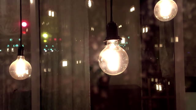 incandescent idea science thought filament lamps. vintage lamp decoration in home night - vídeo