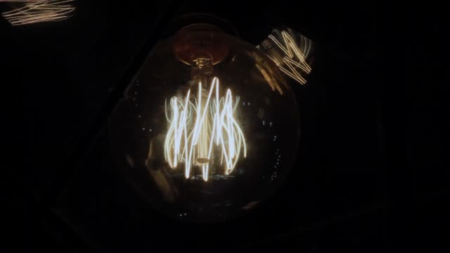 Incandescent lamp in the plafone on the wall Incandescent lamp in the plafone on the wall tungsten image stock videos & royalty-free footage
