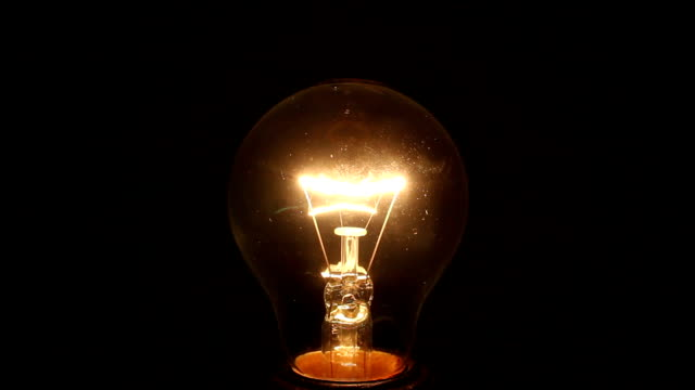 分離された黒の白熱ランプ - 電球点の映像素材/bロール