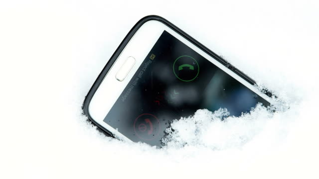 Incoming call on display of lost smart phone in snow video
