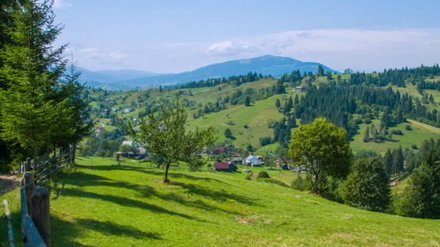 Incredible landscape of green mountains in late summer. Village in the Carpathian mountains, Ukraine. video