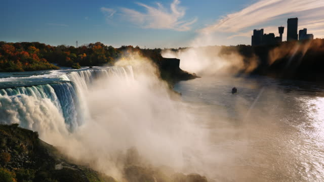 incredible niagara falls at sunset. the sun's rays shine on the canadian shore in the direction of the waterfall. view from above - niagara falls stock videos & royalty-free footage