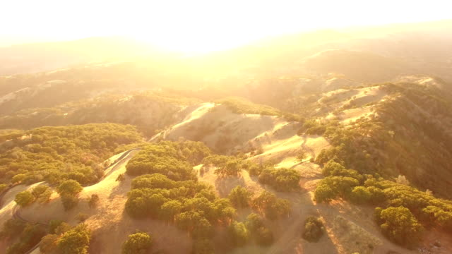 Incredible Sunlight Bursting Over Horizon Over California Hills by Drone California, Observatory - Sunset, Drone low lighting stock videos & royalty-free footage