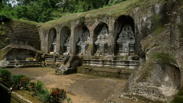 Incredibly beautiful landmark located in the rock. Historical monuments on the island of Bali. Old building made by human hands video