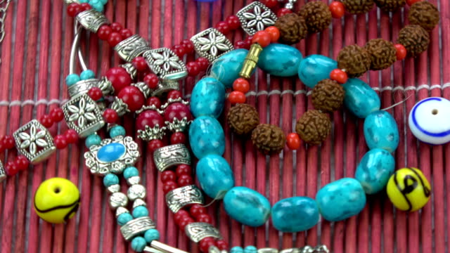 Indian bracelet armlet and old beads rotating background