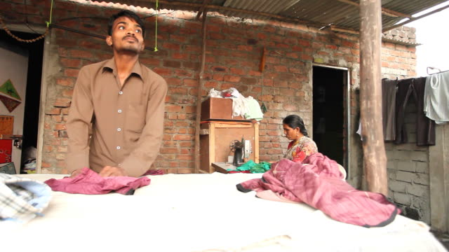 Indian Dhobi washer man and a Woman with Sewing Machine video