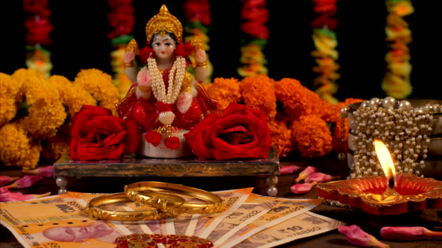 Indian festival Diwali celebration with goddess Lakshmi /  Hindu goddess of wealth, love, prosperity celebrating the occasion of Deepawali with the decoration of wealth flowers and goodness sari stock videos & royalty-free footage