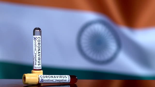 stockvideo's en b-roll-footage met indiase vlag flapperen achter de bloedtest buizen - india