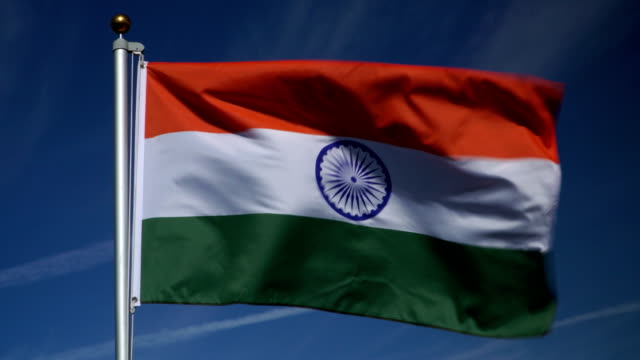 4K: Indian Flag on Flagpole in front of Blue Sky outdoors (India) video