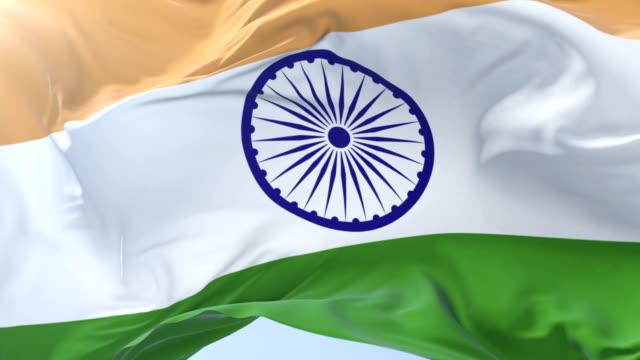 Indian flag waving at wind in slow in blue sky, loop video
