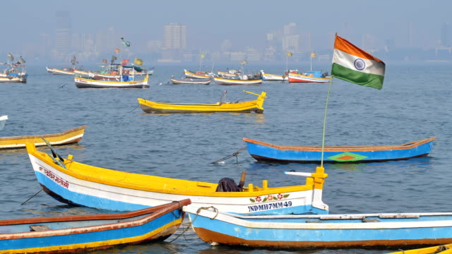 Indian flag waving on parked fishing boat in Mumbai, India video