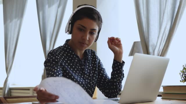 Video Indian girl internet teacher wear headphones teach online by webcam