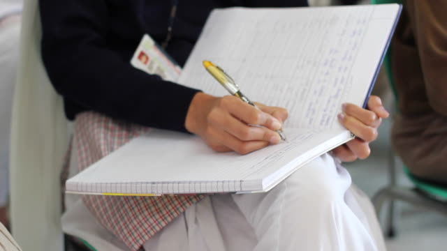 Indian girl writing in her notebook video