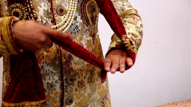 Indian groom getting ready for wedding video