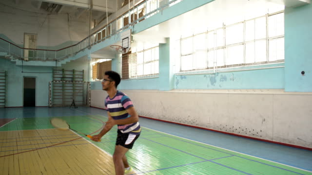 indian guy play badminton, beat the valance bowl - badminton stock videos & royalty-free footage